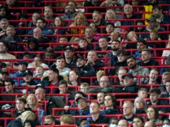 Fans in the new rail seating section at Manchester United's pre-season friendly against Brentford (Nick Potts/PA)