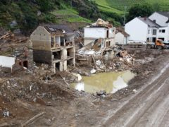People's homes were destroyed after flood water ripped through a village (Thomas Frey/dpa via AP)