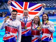 Great Britain's Adam Peaty, James Guy, Anna Hopkin and Kathleen Dawson receive their Gold medals for the Mixed 4 x 100m medley relay (Adam Davy/PA)