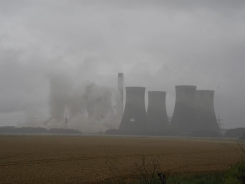 Four of the eight cooling towers at Eggborough power station are demolished by explosives (Peter Byrne/PA)