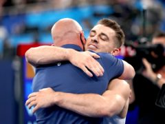 Max Whitlock embraced his coach Scott Hann after defending his Olympic title (Mike Egerton/PA)