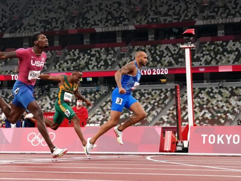 Italy's Lamont Marcell Jacobs wins the 100m in Tokyo. (Martin Rickett/PA)
