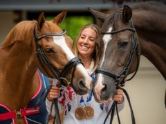Charlotte Dujardin with her Tokyo 2020 Olympic winning horse Gio, left, and former Olympic gold medal winner Valegro (Ben Birchall/PA)