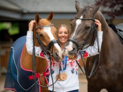Charlotte Dujardin with her Tokyo 2020 Olympic winning horse Gio (left) and former Olympic gold medal winner Valegro (Ben Birchall/PA)