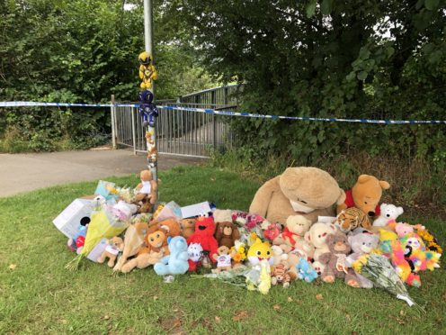 Tributes have been left by the river (Claire Hayhurst/PA)
