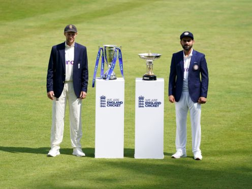 England's Joe Root, left, and India's Virat Kohli pose with the series trophies (Zac Goodwin/PA)