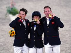 Laura Collett, Tom McEwen and Oliver Townend celebrate their gold medals (Adam Davy/PA)