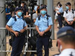 Police officers stand guard outside a court in Hong Kong (Vincent Yu/AP)