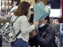 Ben Gilkes goes down on one knee to propose to Cristina Paiva (Karis Pearson/PA)