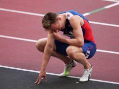 Karsten Warholm reacts after winning the gold medal (Joe Giddens/PA)