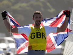 Giles Scott won the gold medal in the men's Finn class at the Tokyo Olympics (PA)