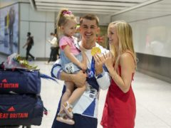Olympic gymnast Max Whitlock, with his wife Leah and daughter Willow (Steve Parsons/PA)