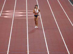 Katarina Johnson-Thompson limps over the line after injury (Martin Rickett/PA)