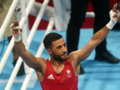 Great Britain's Galal Yafai celebrates victory over Kazakhstan's Saken Bibossinov during the Men's Fly (48-52kg) Semifinal at Kokugikan Arena on the thirteenth day of the Tokyo 2020 Olympic Games in Japan (Adam Davy/PA)