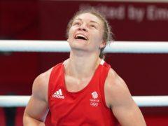 Great Britain's Lauren Price celebrates victory over Netherland's Nouchka Fontijn (Martin Rickett/PA)