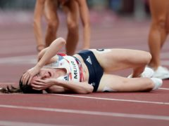 Great Britain's Laura Muir reacts after crossing the line to win silver (Martin Rickett/PA)