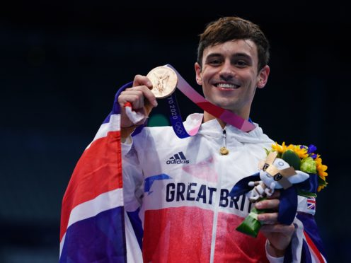 Tom Daley with a bronze medal following the men's 10m platform final (Adam Davy/PA)