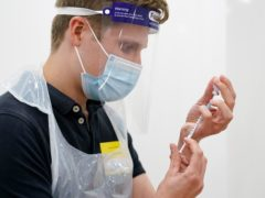 Medical staff prepare a coronavirus vaccination (Jacob King/PA)