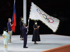 The Olympic flag is handed over by IOC president Thomas Bach to Paris mayor Anne Hidalgo during the closing ceremony of Tokyo 2020 (Martin Rickett/PA)