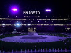 """The word """"Arigato"""" written in lights during the closing ceremony of the Tokyo 2020 Olympic Games (Martin Rickett/PA)"""