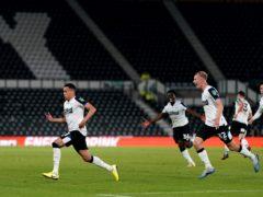 Ravel Morrison (left) celebrates scoring on his debut for Derby against Salford (Tim Goode/PA)