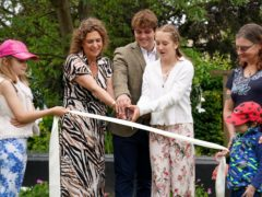 Captain Sir Tom Moore's daughter Hannah Ingram-Moore alongside his grandchildren Benjie Ingram-Moore and Georgia Ingram-Moore officially open a new garden at the Helen and Douglas House children's hospice in Oxford (Jacob King/PA)