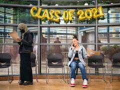 Cyan Benjamin-Neita shares news of her GCSE results by phone (PA)