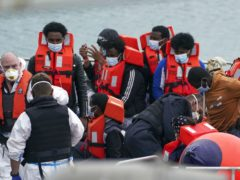 A group of people thought to be migrants are brought in to Dover (PA)