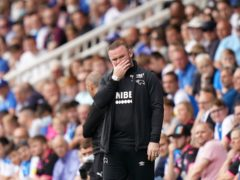 Wayne Rooney saw his Derby side concede twice in added time to lose to Peterborough (Tim Goode/PA).