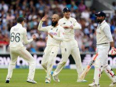 England's Moeen Ali and Joe Root celebrate the dismissal of India's Ravindra Jadeja (Zac Goodwin/PA).
