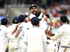 India's Virat Kohli (top) celebrates the wicket of Jonny Bairstow (Zac Goodwin/PA).