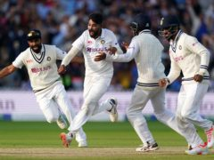 Mohammed Siraj, centre, celebrates taking the final wicket of England's James Anderson (Zac Goodwin/PA)