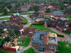 Several houses are damaged by a storm in the German village of Berumerfehn (Joern Hueneke/TNN/dpa via AP)