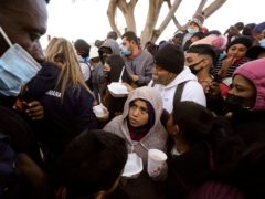 The Supreme Court has refused to block a court ruling ordering Joe Biden's administration to reinstate a Donald Trump-era policy that forces people to wait in Mexico while seeking asylum in the US (Gregory Bull/AP)