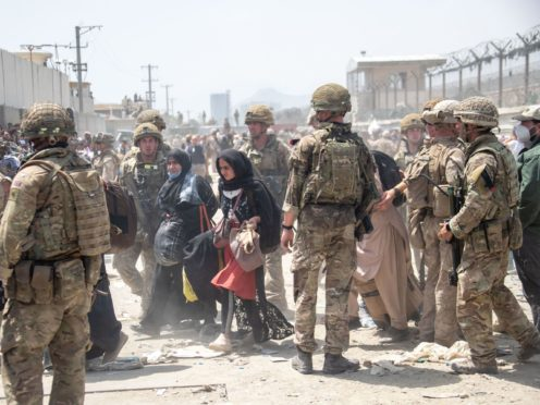 Members of the British and US military engaged in the evacuation of people out of Kabul (Mo/PA)
