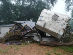 A mobile home and a truck trailer washed away by flooding in McEwen, Tennessee (Mark Humphrey/AP)