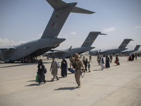 Afghan refugees head to planes as they are evacuated out of Kabul (LPhot Ben Shread/MoD/PA)