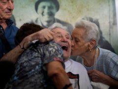 Martin Adler with the siblings he met during the war (Antonio Calanni/AP)