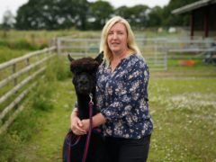 Helen Macdonald poses for a photograph with Geronimo (Andrew Matthews/PA)