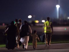British nationals and Afghan evacuees depart a flight from Afghanistan at RAF Brize Norton (Jacob King/PA)