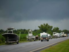 Boats, trailers and RVs line Louisiana Highway 46 after owners moved them to be inside the levee protection zone before Hurricane Ida makes landfall in St Bernard Parish, Louisiana (Matthew Hinton/AP)