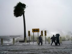A news crew reports on the edge of Lake Pontchartrain ahead of approaching Hurricane Ida in New Orleans (Gerald Herbert/AP)