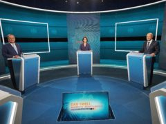Candidates for chancellor from left, Armin Laschet, Annalena Baerbock and Olaf Scholz stand before the broadcast in the TV studio in Berlin (Michael Kappeler/AP)