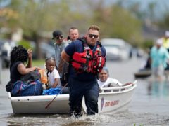 Members of the Louisiana State Fire Marshal's office rescue people from floodwaters (Gerald Herbert/AP