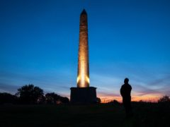 The Wellington Monument is illuminated to mark the end of the restoration project (John Miller/National Trust/PA)