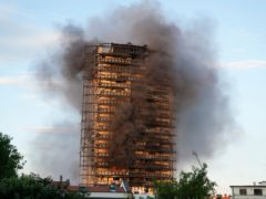 Firefighters battled a blaze that spread rapidly through a recently restructured 16-storey residential building in Milan (Luca Bruno/AP)
