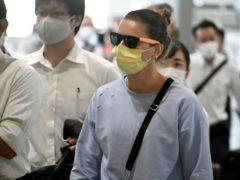 Krystsina Tsimanouskaya at Narita International Airport (Kyodo News via AP)
