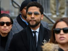 """FILE – In this Feb. 24, 2020 file photo, former """"Empire"""" actor Jussie Smollett leaves the Leighton Criminal Courthouse in Chicago. A judge on Monday, Aug. 2, 2021, granted lawyers for Jussie Smollett more time to prepare arguments on several issues, including whether they can introduce a key witness's previous conviction for battery.Cook County Judge James Linn Linn scheduled the next hearing in the case for Aug. 26. (AP Photo/Matt Marton, File)"""