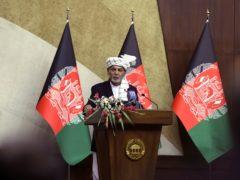 Afghan President Ashraf Ghani speaks at the extraordinary meeting of the Parliament in Kabul, Afghanistan (Rahmat Gul/AP)