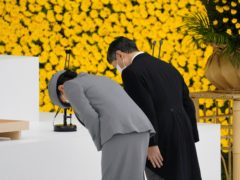 Japan's Emperor Naruhito (right) and Empress Masako bow during a ceremony to mark the 76th anniversary of Japan's surrender (Toru Hanai/Pool Photo via AP)
